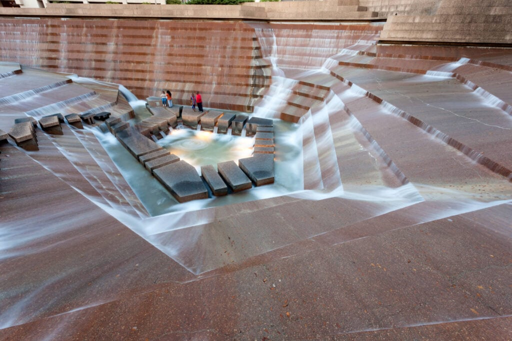 Water flows down a staircase like concrete park
