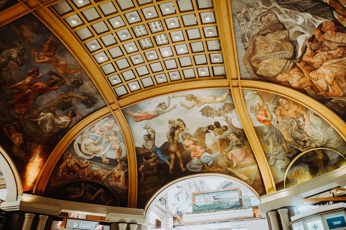 A dome painted with gold accents and murals