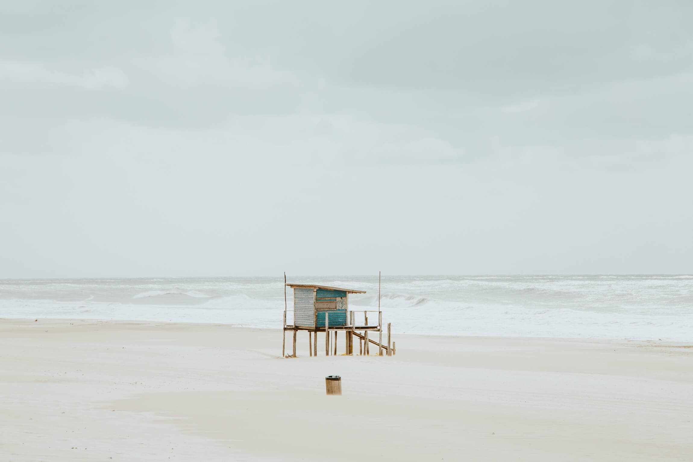 A blue lifeguard stand on the beach