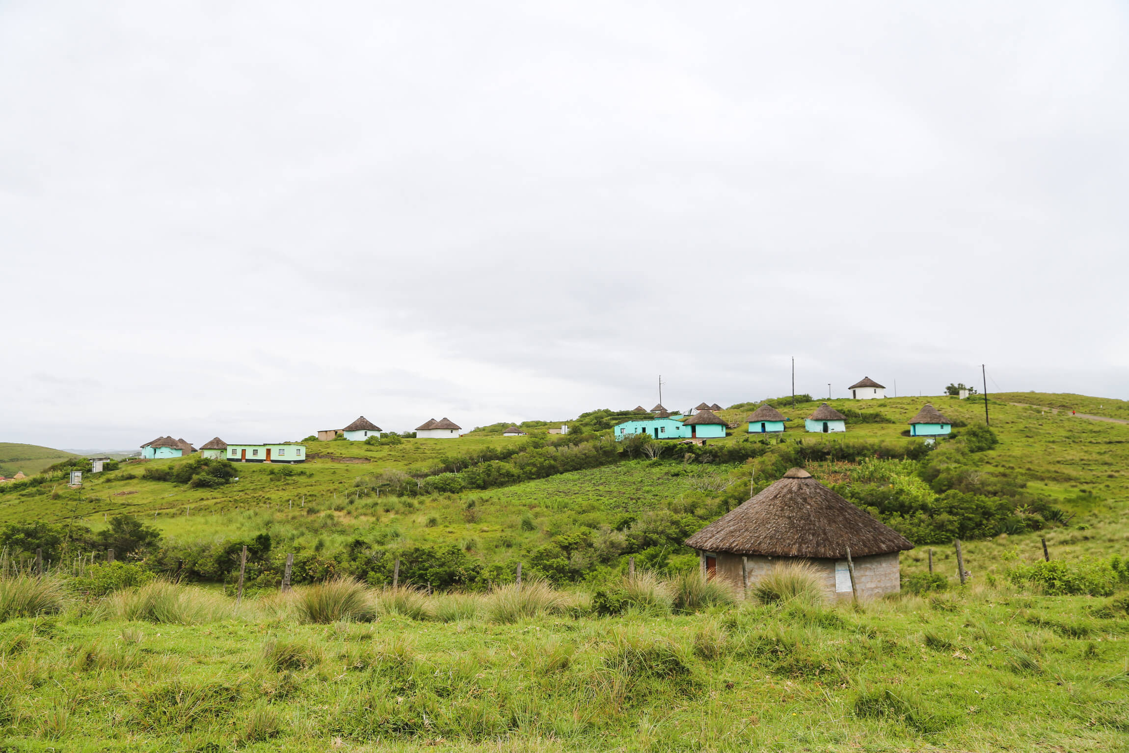 Round huts with thatched roofs on a hill
