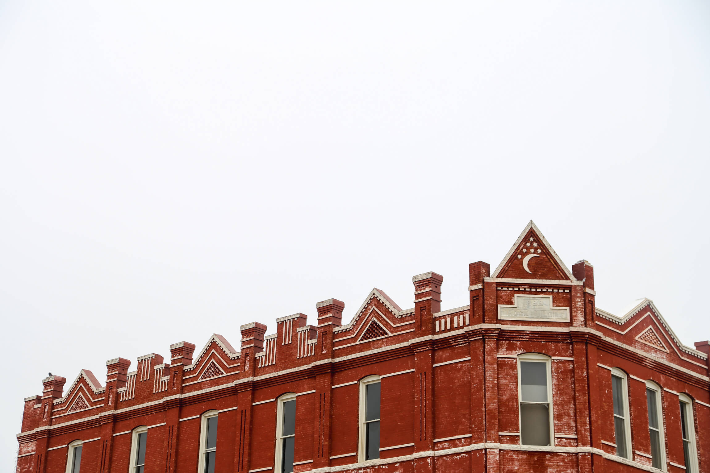 A red brick building and a white sky