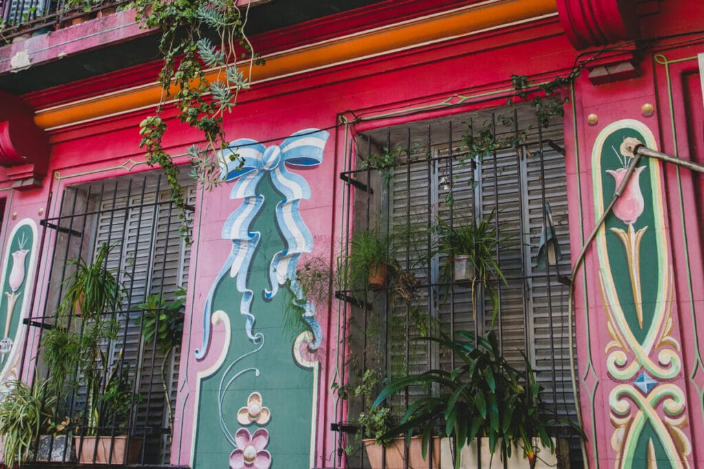 A red building facade painted in swirly designs