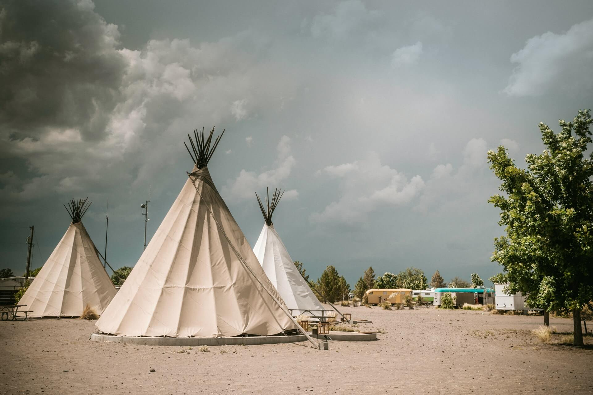 Three teepees in the desert
