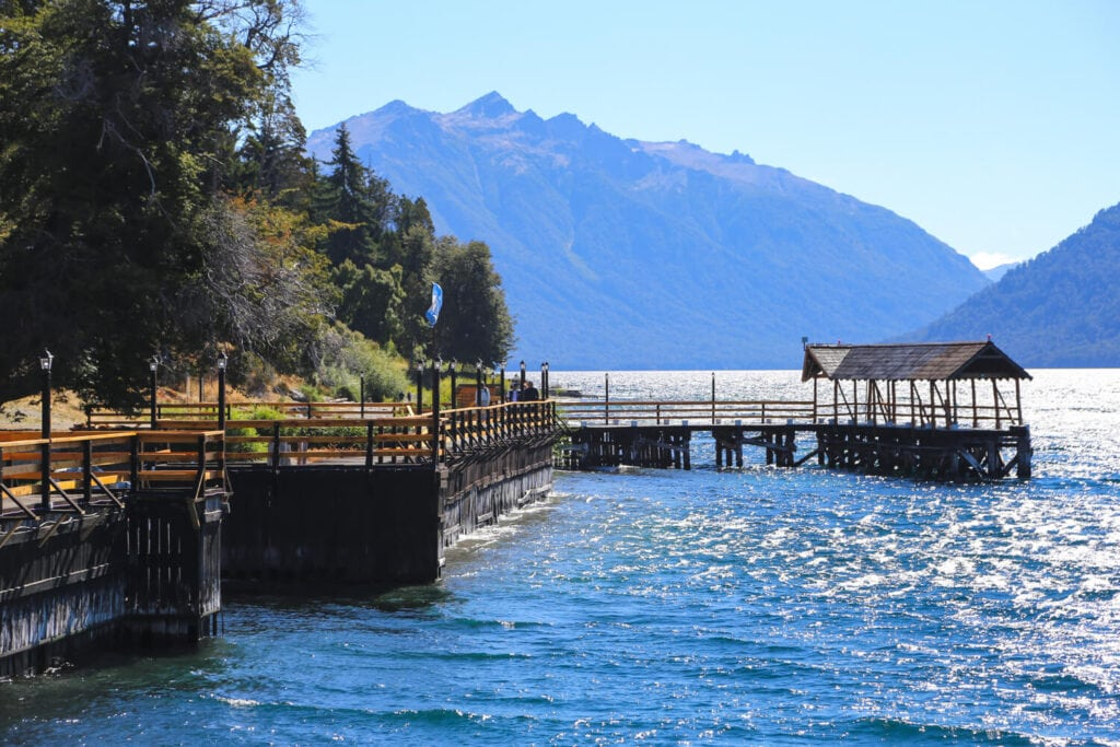 A wooden pier on a lake in the mountains