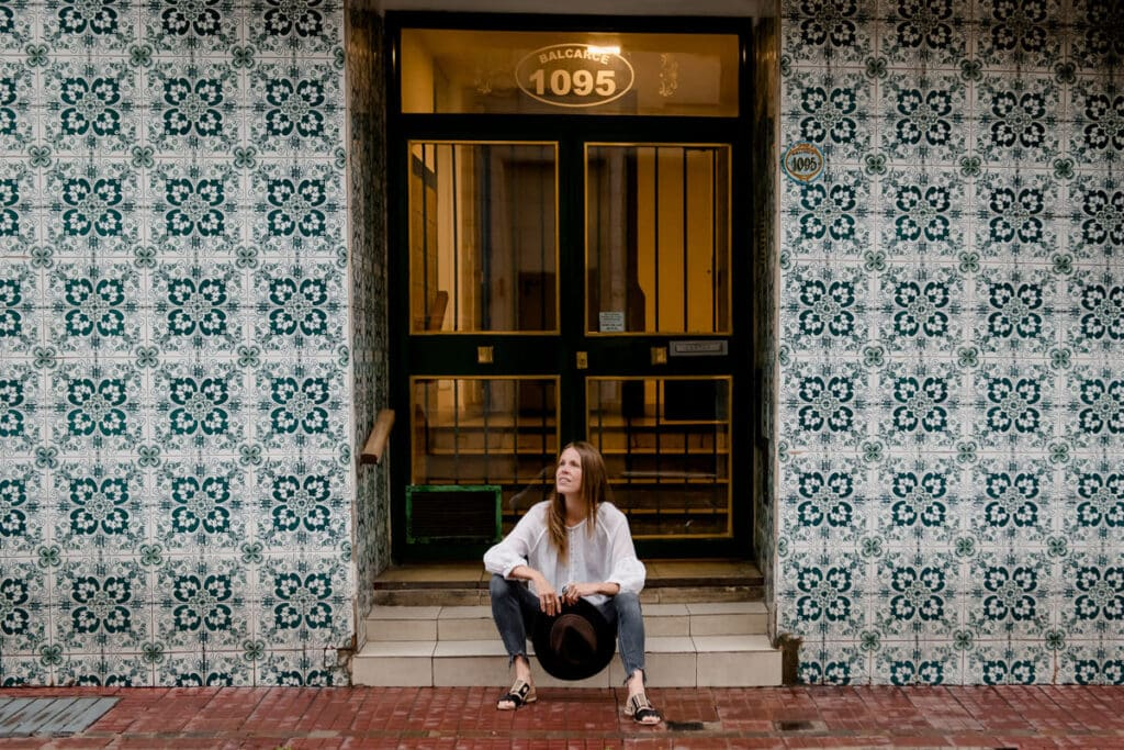 A woman sitting on a apartment stoop